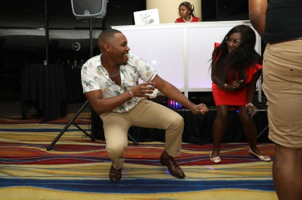 Jasper Bothuel of Detroit and Student Representative, Kyra Azore, dance at the President's Reception in honor of NABJ President, Sarah Glover, at the Detroit Marriott, August 2, 2018.